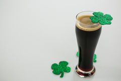 St Patricks Day glass of beer with shamrock. On white background Royalty Free Stock Images