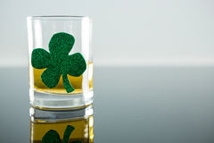 St Patricks Day glass of beer with shamrock. On white background Royalty Free Stock Image
