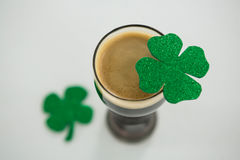 St Patricks Day glass of beer with shamrock. On white background Stock Photo