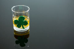St Patricks Day glass of whisky with shamrock Royalty Free Stock Image