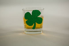 St Patricks Day glass of whisky with shamrock Royalty Free Stock Images