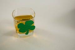 St Patricks Day glass of whisky with shamrock Royalty Free Stock Photo