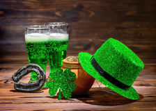 St Patricks day with glasses of green beer, leaf clover, leprech Stock Images