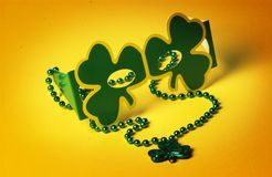 St Patricks day glasses and necklace Royalty Free Stock Image