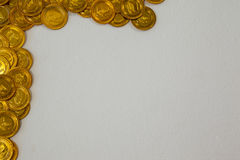 St Patricks Day gold chocolate coins forming corner frame. On white background Stock Image