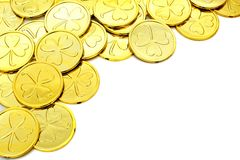 St Patricks Day gold coin border. St Patricks Day gold coin corner border over a white background Stock Image