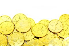 St Patricks Day gold coin border. Over a white background Royalty Free Stock Photo
