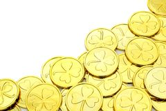 St Patricks Day gold coin border. Over a white background Royalty Free Stock Photos