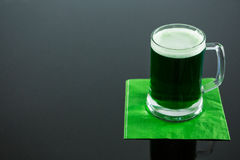St Patricks Day green beer on napkin Royalty Free Stock Photography