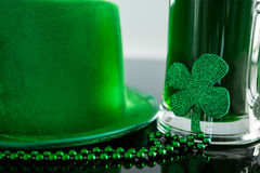 St Patricks Day green beer with shamrock, leprechaun hat and bead Royalty Free Stock Photography