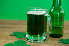 St Patricks Day green beer with shamrock. On wooden surface Royalty Free Stock Photography