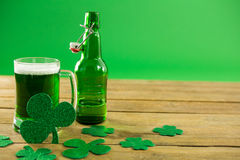 St Patricks Day green beer with shamrock. On wooden surface Stock Photo