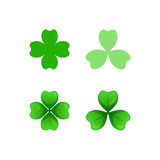 St Patricks Day. Green clover sprigs icons with three and four leaves. St Patricks Day clip-art. Vector cartoon and flat style design element, isolated on white Royalty Free Stock Photos