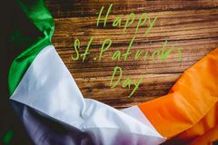 St patricks day greeting. On wooden background Royalty Free Stock Photos