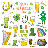 St Patricks Day hand drawn doodle set, with leprechaun, pot of gold coins, rainbow, beer, four leaf clover, horseshoe, celtic harp Royalty Free Stock Photo