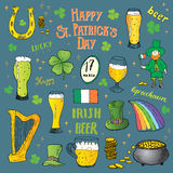 St Patricks Day hand drawn doodle set, with leprechaun, pot of gold coins, rainbow, beer, four leaf clover, horseshoe, celtic harp Royalty Free Stock Images