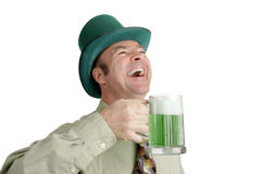 St Patricks Day Laughter. An Irish man on St. Patrick's Day, enjoying a green beer and a good laugh.  Isolated on white Stock Photography