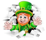 St Patricks Day Leprechaun Breaking Wall. A cute St Patricks Day Leprechaun cartoon character breaking through the background brick wall Royalty Free Stock Images