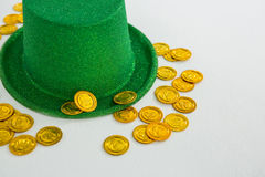 St. Patricks Day leprechaun hat and chocolate gold coins Stock Photos