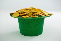 St. Patricks Day leprechaun hat filled with chocolate gold coins Royalty Free Stock Photos