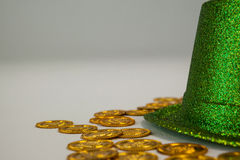 St Patricks Day leprechaun hat with gold chocolate coins. on white background Stock Image
