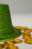 St Patricks Day leprechaun hat with gold chocolate coins. on white background Stock Photography