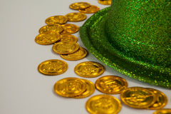St Patricks Day leprechaun hat with gold chocolate coins Stock Photography