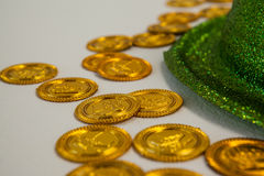 St Patricks Day leprechaun hat with gold chocolate coins. on white background Stock Photo