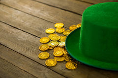 St Patricks Day leprechaun hat with gold chocolate gold coins Royalty Free Stock Image