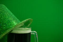 St Patricks Day leprechaun hat with mug of green beer Stock Images