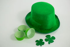 St Patricks Day leprechaun hat with shamrock and cup cake case Royalty Free Stock Photo