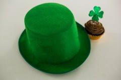 St Patricks Day leprechaun hat with shamrock on cupcake Stock Photos