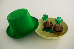 St Patricks Day leprechaun hat with shamrock on cupcake Royalty Free Stock Photography