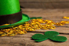 St Patricks Day leprechaun hat with shamrock and gold chocolate coin Stock Photo