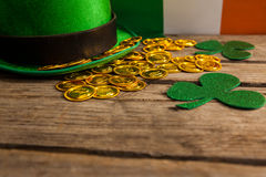 St Patricks Day leprechaun hat with shamrock and gold chocolate coin Royalty Free Stock Image