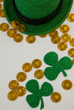 St. Patricks Day leprechaun hat, shamrocks and chocolate gold coins Stock Photo