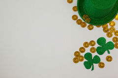 St. Patricks Day leprechaun hat, shamrocks and chocolate gold coins Royalty Free Stock Photo
