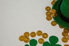St. Patricks Day leprechaun hat, shamrocks and chocolate gold coins Stock Photography