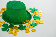 St. Patricks Day leprechaun hat, shamrocks and chocolate gold coins Stock Photos