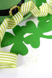 St Patricks Day leprechaun hat with shamrocks. Happy St Patricks Day leprechaun hat with shamrocks and party ribbons on white table royalty free stock photography