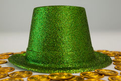 St Patricks Day leprechaun hat surround with gold chocolate coins. On white background Stock Photography