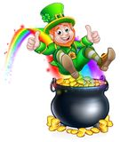 St Patricks Day Leprechaun Pot of Gold Rainbow. A cute St Patricks day leprechaun cartoon character sliding on rainbow into a pot of gold and giving a thumbs up Stock Photography