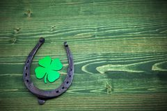 St. Patricks day, lucky charms on green wooden background