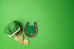 St. Patricks day, lucky charms. Horesechoe and shamrock on green background Royalty Free Stock Photo