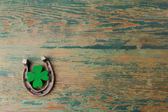 St. Patricks day, lucky charms. Horesechoe and shamrock on wooden background Royalty Free Stock Photos