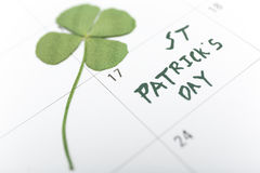 St patricks day on march calendar pin. Stock Images