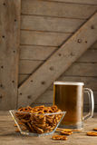 St Patricks Day mug of beer with pretzel Stock Photography