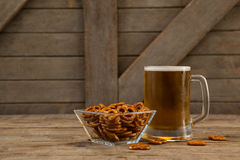 St Patricks Day mug of beer with pretzel Stock Photo