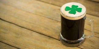 St Patricks Day mug of beer with shamrock Stock Photos