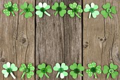 St Patricks Day paper shamrock double border over rustic wood Stock Image